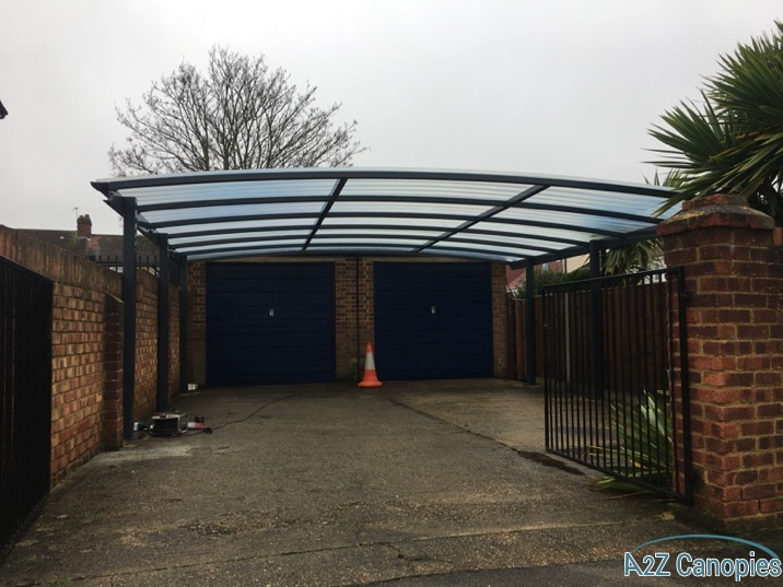 boxed steel is galvanised and, can be, powder coated to the required finish for the canopy. grp sheeting is installed that is 3mm thick but made from strong fibers.